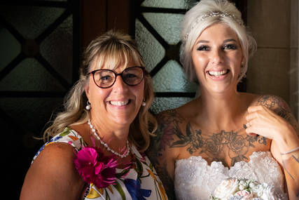 A bride and wedding guest.