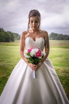 A bride stands gazing into a bouquet of flowers outside the Ferriby Hallmark Hotel near Hull.