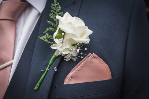 A detail shot of the groom's button hole.