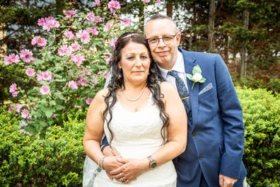 A bride and groom pose for a photograph outside The Villiage Hotel near Hull.