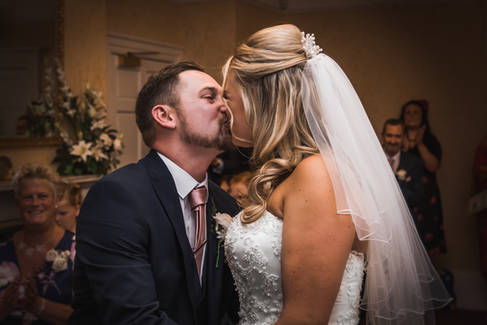 A bride and groom exchange a kiss in Beverley Registry Office.