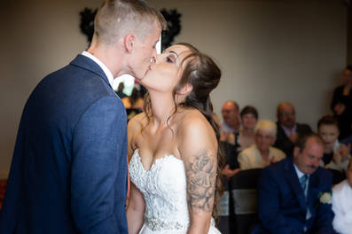 A bride and groom kiss during their wedding ceremony at the Hallmark Hotel near Hull.