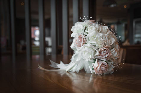 A bridal bouquet, isolated on a wooden table.