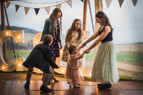 Five children dance at a marquee reception at Little Wold Vineyard, East Yorkshire.