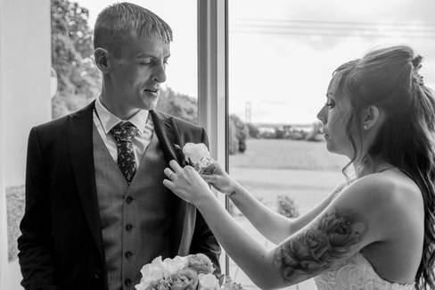 A bride fixes the button hole of her groom at the Hallmark Hotel near Hull.