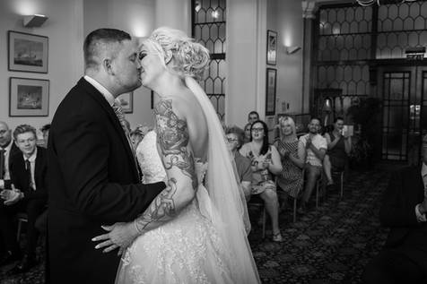 A bride and groom kiss during their wedding ceremony at Hull Guild Hall.