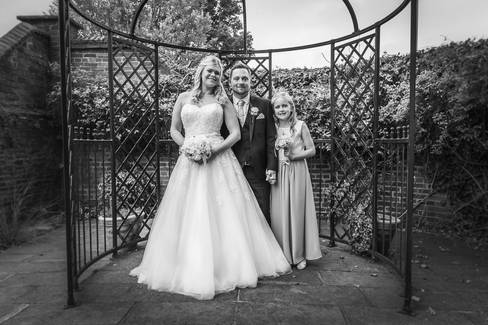 A bride and groom are photographed in the garden at Beverley Registry Office.