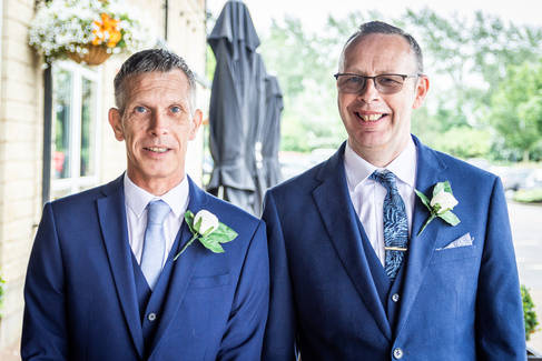 The groom and best man outside The Villiage Hotel near Hull.