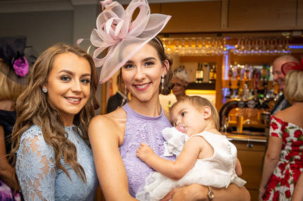 Three wedding guests smile for a photograph at The Village Hotel near Hull.