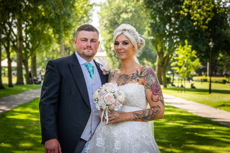 A close up shot of the brie and groom In Queens Gardens, Hull.