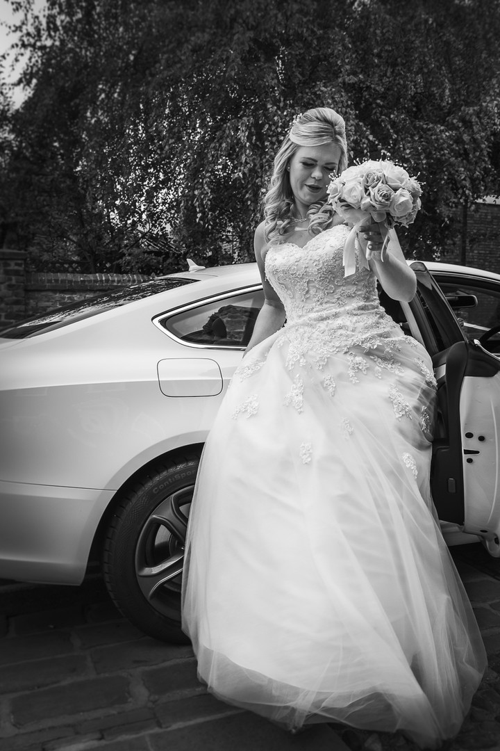 A bride is shown leaving the bridal car outsite Beverley Registry Office.