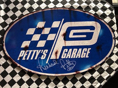 Vintage distressed Petty Garage metal sign