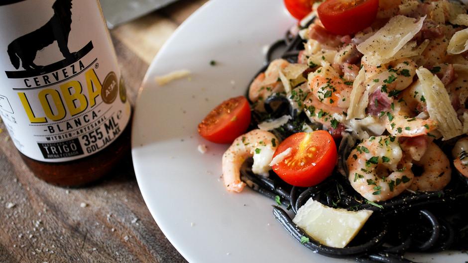 Black Squid Ink Pasta with Prawns, Pancetta, Cherry Tomatoes and Cerveza Loba Blanca