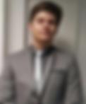 A HeadStart apprentice in a grey suit