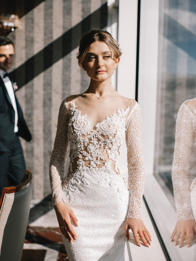 woman-in-white-lace-dress-standing-besid