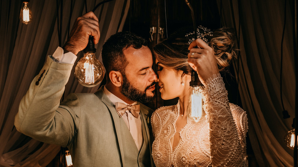 man-and-woman-holding-lights-while-kissi