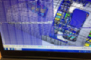 an operator presses save on a simulation project designing the layout for a new factory for a customer