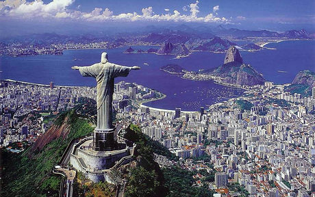 statue of christ the redeemer stretches his arms gazing over the coastal city of Rio de Janeiro