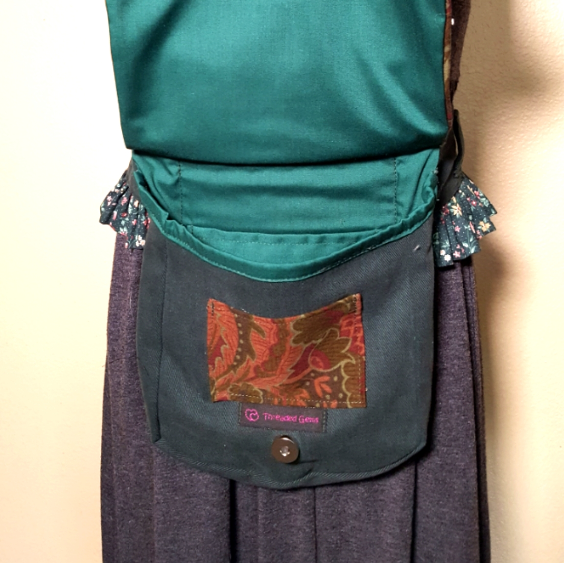Ruffled hip bag maroon and green 1 open.