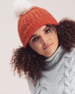 Loving this orange knitted bobble hat fr