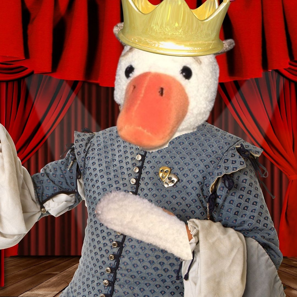 Duck, dressed in an Elizabethan king's costume, is onstage.