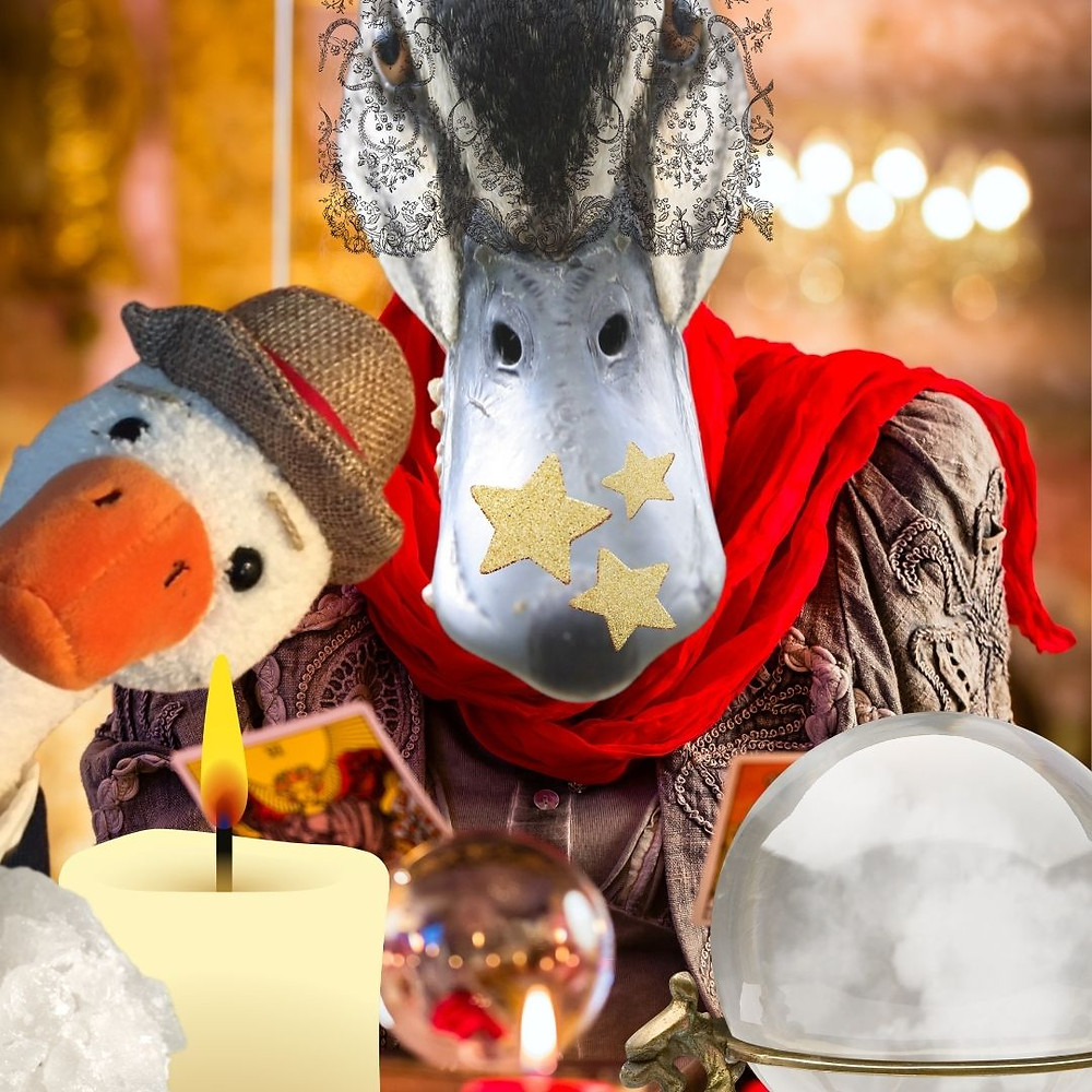 The Duck of Destiny wears a lace veil and has gold stars stuck onto her beak. She is sitting in front of crystal balls, oracle cards, and candles. Duck T is also in the image.