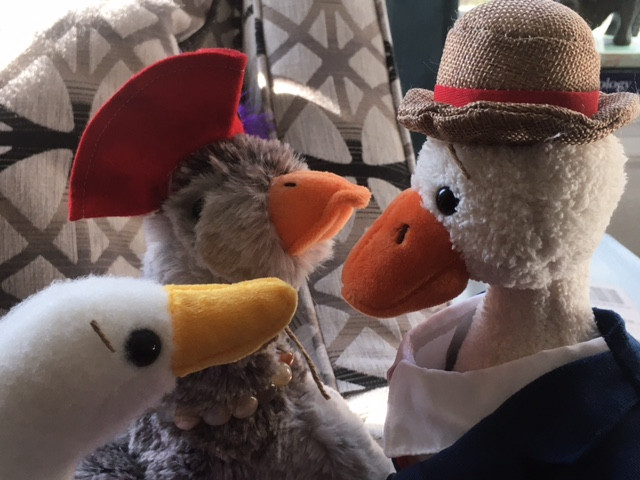 Duck is being listened to by Goose Luce and Swan Juan. All three are stuffed animals.
