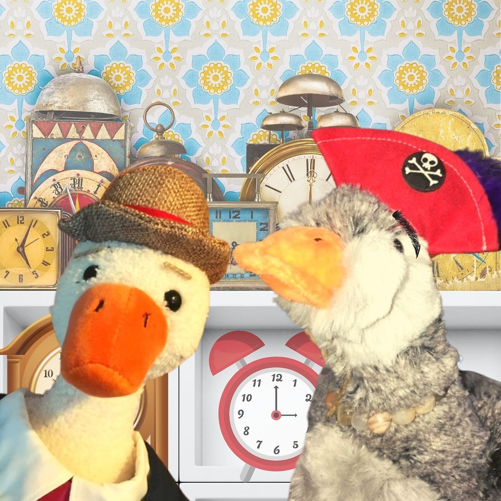 Duck and Goose Luce stand in front of shelves of antique-looking clocks. Luce wears a red pirate hat.