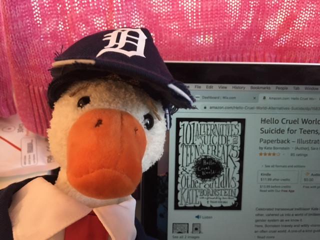 "Duck posing with Kate Bornstein's ""Hello Cruel World"" via Amazon"