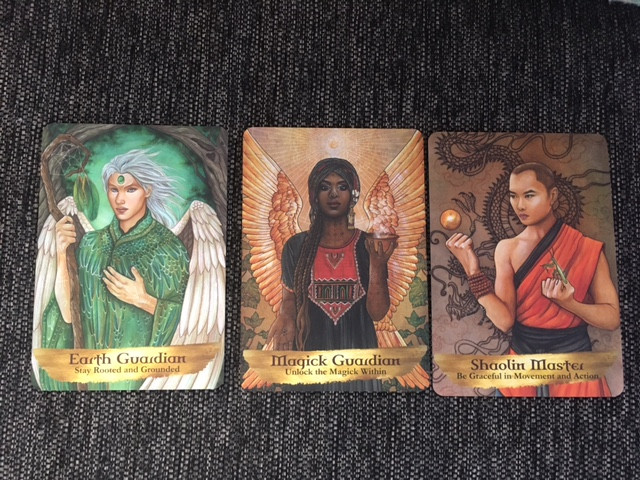 Three cards from Kyle Gray's deck (including non-binary guardian, to the left). Two of the figures are people of color: A Shaolin Master and a Magick Guardian.