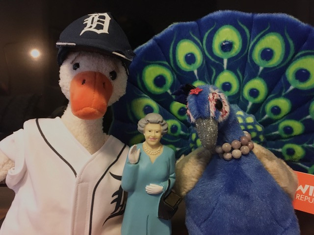 Duck and Peacock Riley pose with a miniature model of Queen Elizabeth