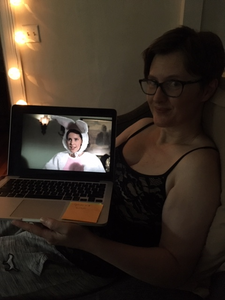 A photo of me, holding a picture of Anya from Buffy, dressed in a bunny costume.