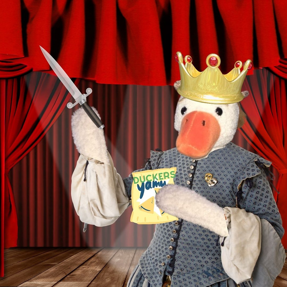 Duck, dressed as Duckbeth on stage, this time wields a dagger, as well as a branded packet of chips.