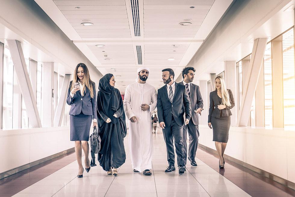 Multiethnic group of businesspeople meet