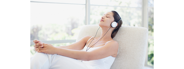 Woman Relaxing With a Hypnotic Audio from Hypno Reset by Ilona Hawser Hypnotherapy