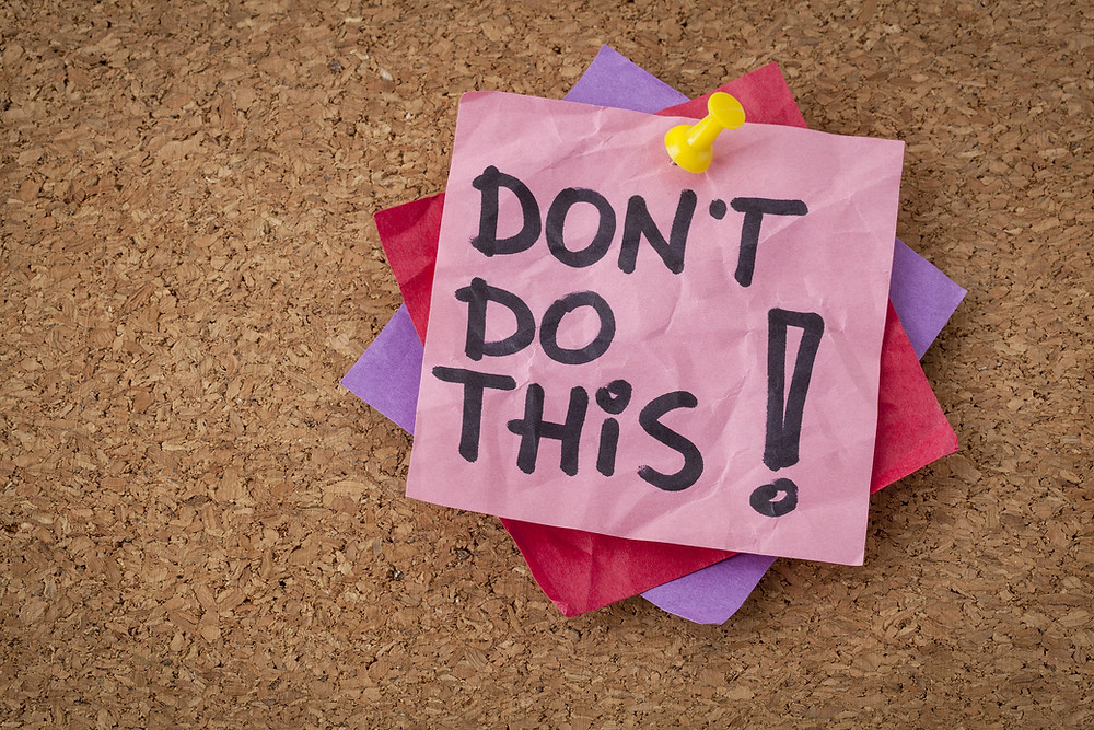 do not do this  advice or warning - handwriting on pink sticky note.jpg