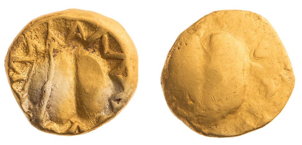 Zlatá třetina zlatého statéru vyražená prasklým razidlem. Foto T. Smělý
