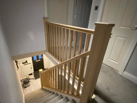 Oak balustrade and under stair cupboard in lofthouse.