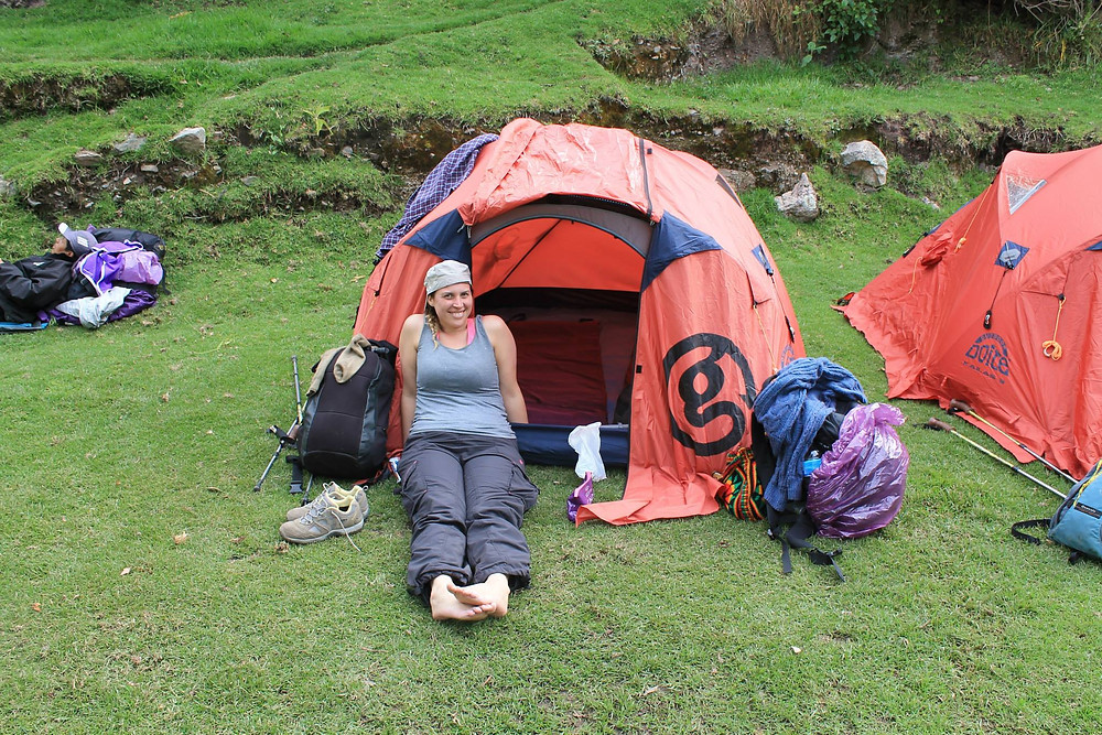 Day 2 Camp Site. Of course we're all smiles at the chance to rest our feet.