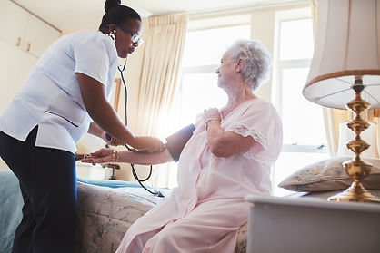 female-nurse-checking-blood-pressure-of-