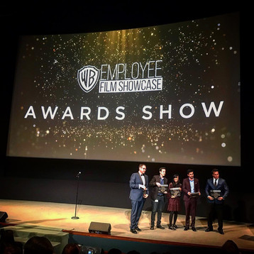 Jake Thomas receives award at Warner Brothers Employee Film Showcase.jpg