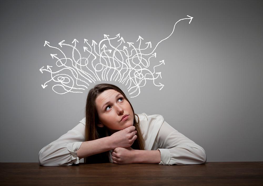 Girl sitting at desk thinking