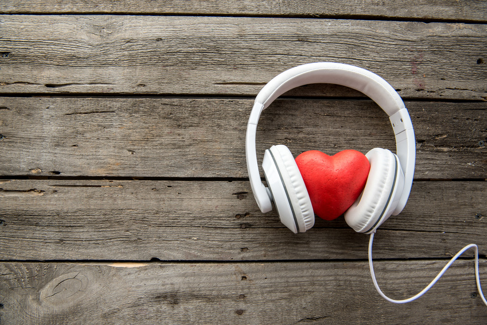 Toy heart listening to headphones
