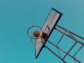 basketball-and-backboard-under-blue-sky-