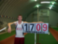 "National HS Indoor Record (17'09.25"")"