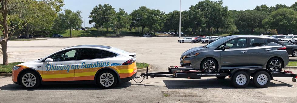 Tesla Model X towing Nissan LEAF