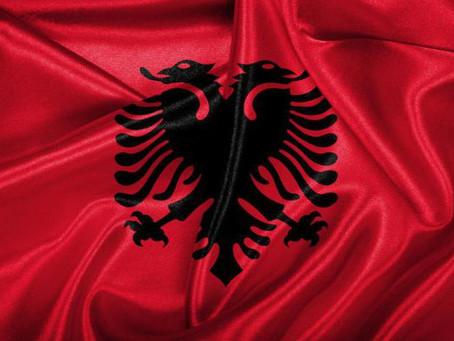 שושנה ויג| הכוח הרוחני הספרותי המאוחד של העולם: שליחות המשורר האלבני אַגרוֹן שֶׁל (Agron Shele)