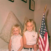 Debra right holding flag with little sister Tanya