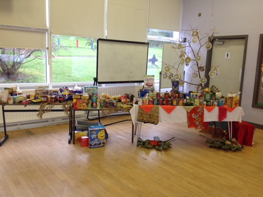 Oak Class (Y6) help to pack all our school's Harvest offerings.  They will be distributed around Nor