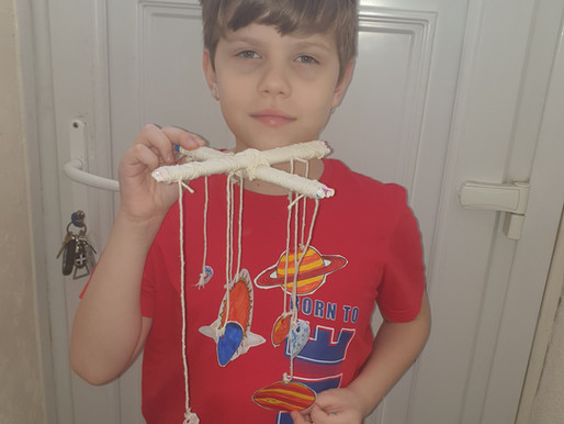 This boy has made his own model of the Solar System. What a clever idea!
